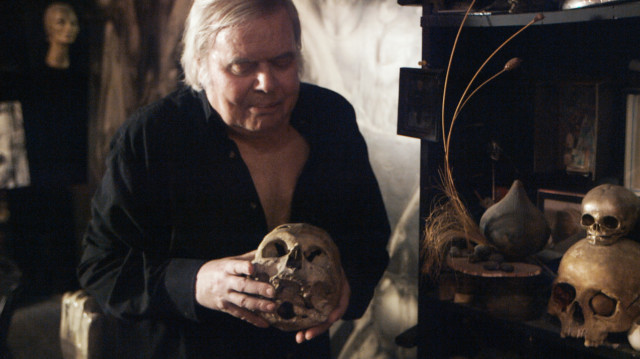 Giger holding his first human skull. It was a gift from his father when Giger was only six. In the film, Giger explains that he would drag the skull down the street by a string.